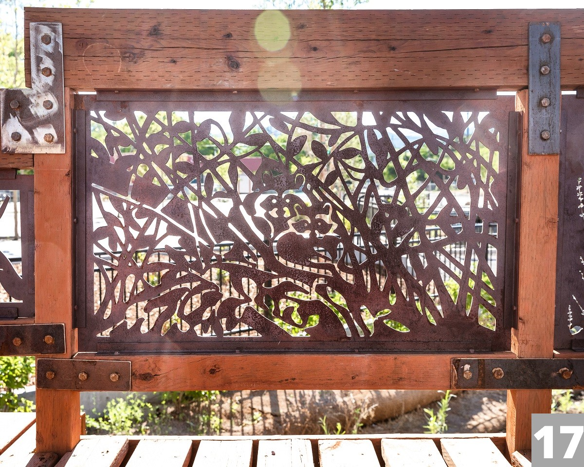 A Corten steel panel laser cut with a design for the Three Creeks Confluence Park